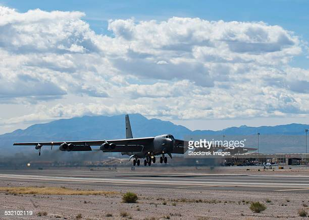 A B-52 Stratofortress takes off from Nellis Air Force Base.