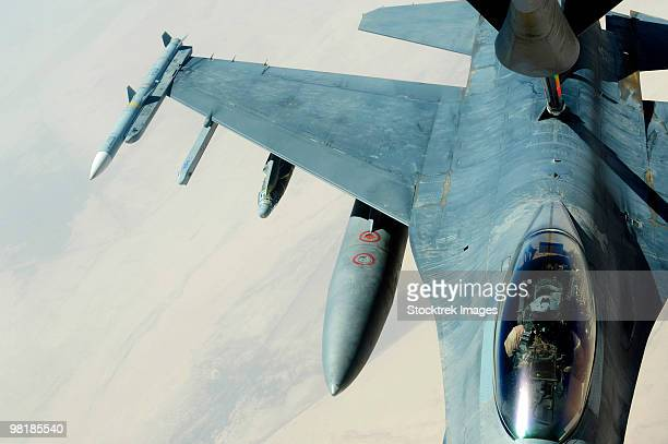 A KC-135 Stratotanker refueling an F-16CJ Fighting Falcon over Iraq.