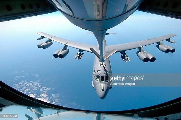 A KC-135 Stratotanker refuels a B-52 Stratofortress over the Indian Ocean.