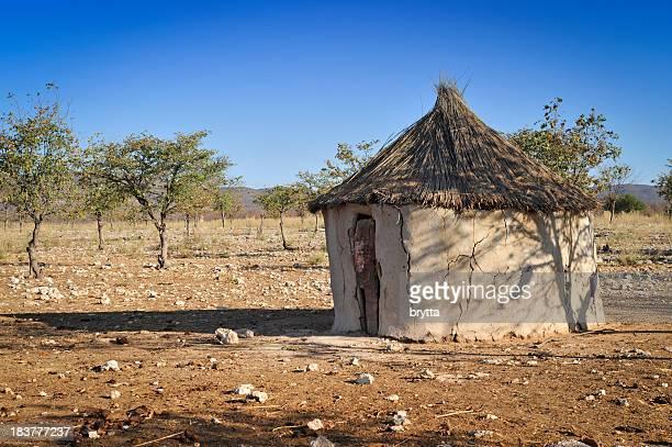 Straw and mud African hut on prairie