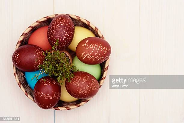 Straw bowl full of Easter decorations. Debica, Poland