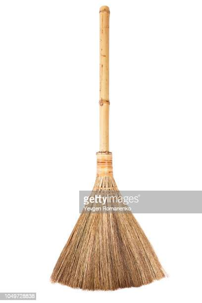 straw broomstick isolated on white background - broom stock pictures, royalty-free photos & images