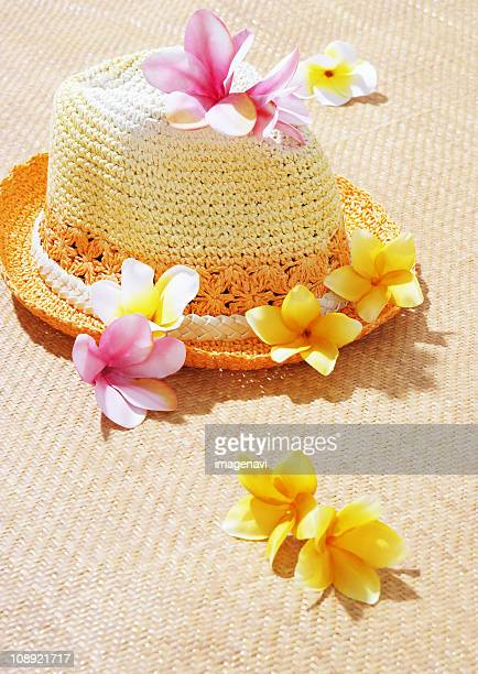 Straw hat and frangipani