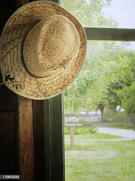 Straw hat close to window