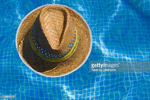 Straw hat in pool