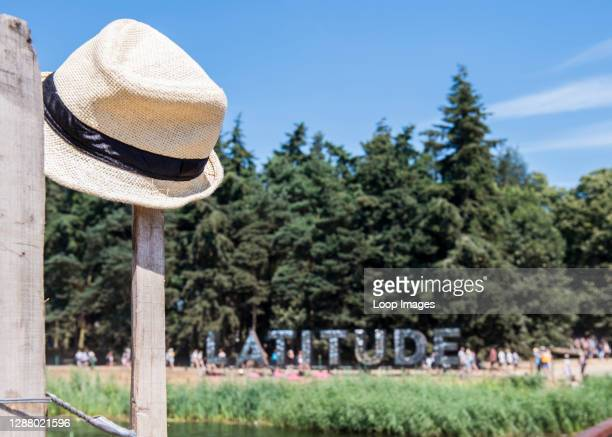 Straw hat left hanging from a post near the Latitude sign at Latitude Festival 2018.