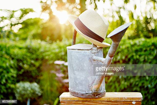 Straw hat on watering can