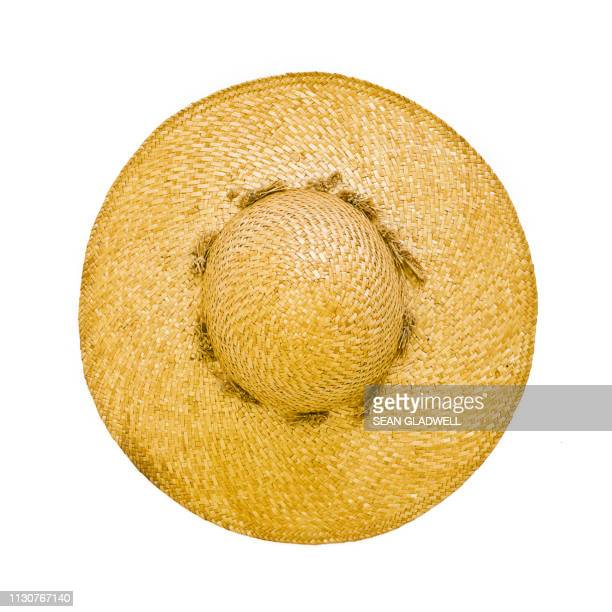 straw hat white background - hat stock pictures, royalty-free photos & images