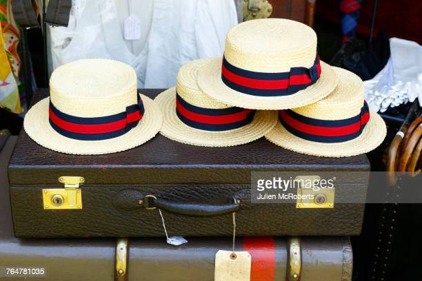 straw hats on old-fashioned briefcase - roaring 20s party stock photos and pictures