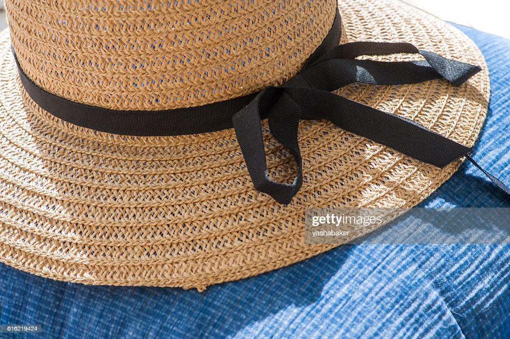 Straw summer hat on blue background : Photo