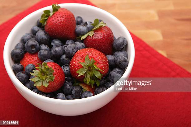 strawberries and blueberries bowl - lori lee stock pictures, royalty-free photos & images
