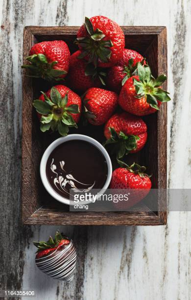 strawberries and chocolate - chocolate dipped stock pictures, royalty-free photos & images