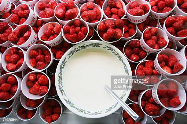 Strawberries and cream are prepared during day three of the Wimbledon Lawn Tennis Championships at the All England Lawn Tennis and Croquet Club on...