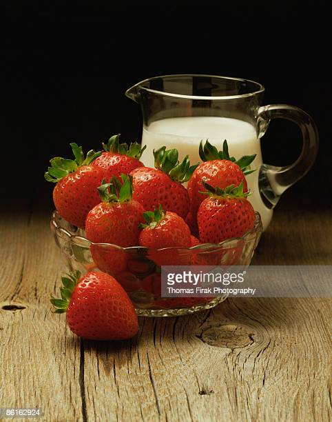 strawberries and cream -  firak stock pictures, royalty-free photos & images