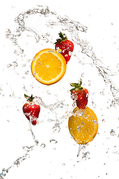 Strawberries And Orange Slices In A Water Splash Wall Art