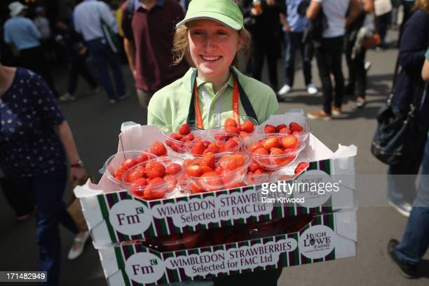 Strawberries are carried around the grounds during day two of the Wimbledon Lawn Tennis Championships at the All England Lawn Tennis and Croquet Club...