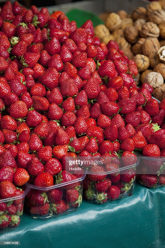 Strawberries at an outdoor market : Stock Photo