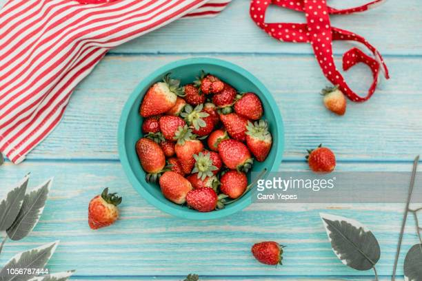 strawberries in blue wooden background - carol cook stock pictures, royalty-free photos & images