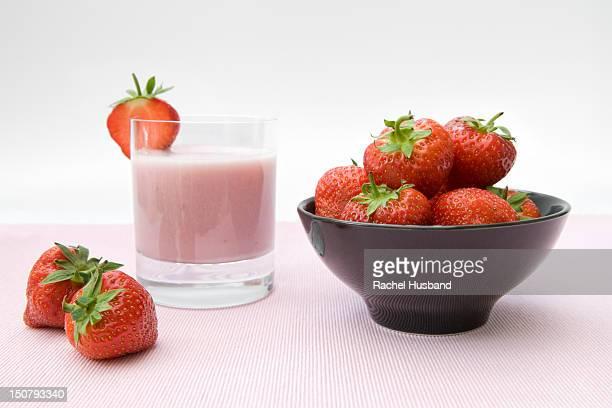 strawberries in bowl and strawberry milkshake - strawberry milkshake and nobody stock pictures, royalty-free photos & images