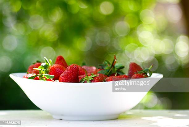strawberries in bowl - annfrau stock pictures, royalty-free photos & images
