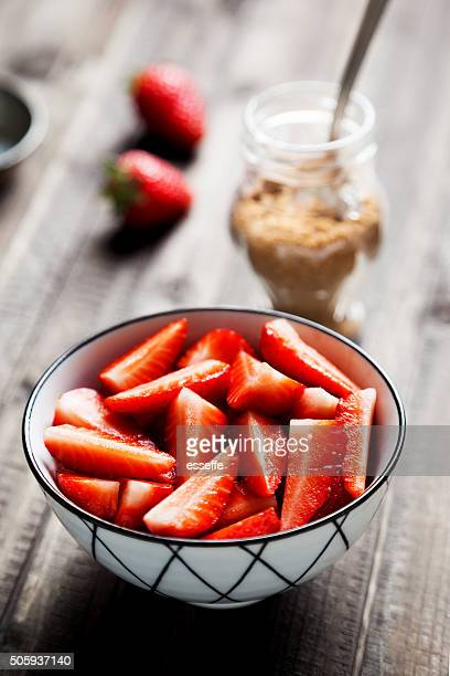 Strawberries in bowl with brown sugar