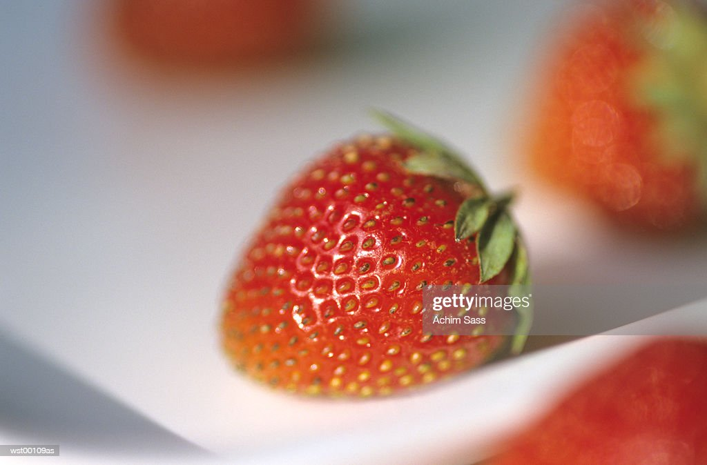 Strawberries in tray, close up : Stock Photo