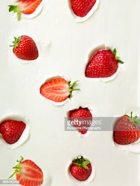 strawberries in yoghurt - strawberry stock pictures, royalty-free photos & images
