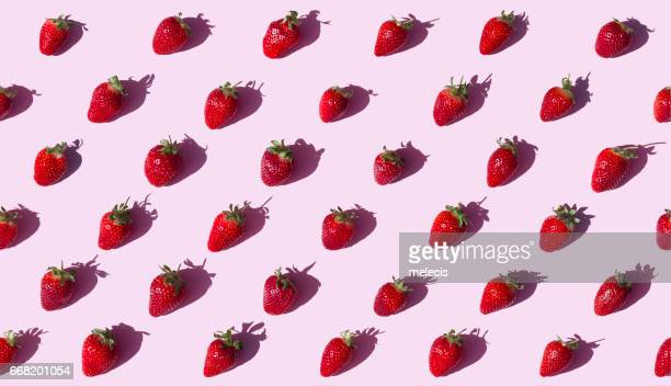 Strawberries on pink background seamless