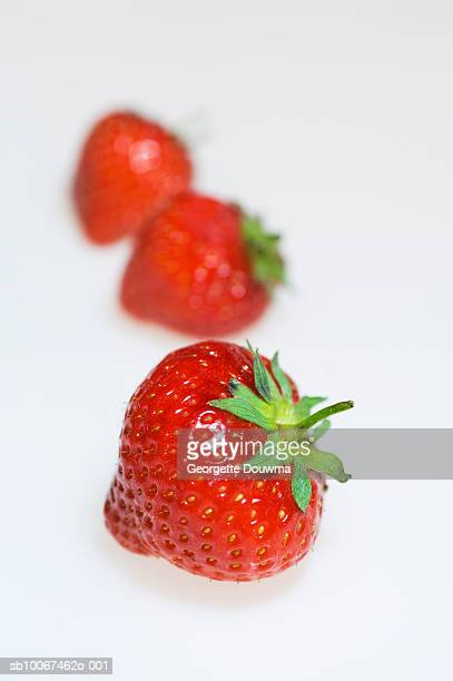 Strawberries on white background, close-up