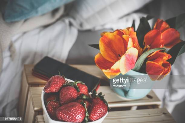 Strawberries set out as a snack on a bedside table
