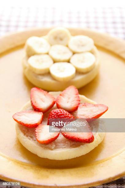 Strawberry and banana slicing on English muffins