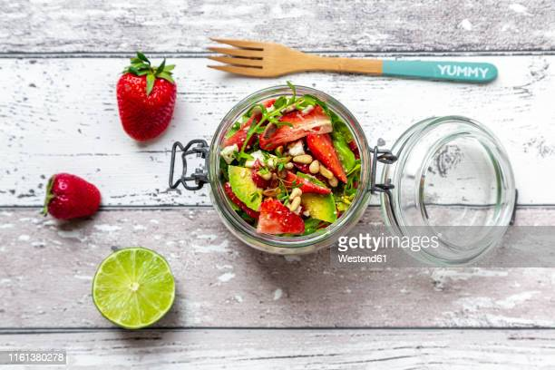 strawberry avocado salad with feta, rocket and pine nuts in jar - jars with salad stock pictures, royalty-free photos & images