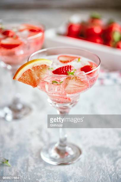 strawberry blood orange spritzers cocktail - prosecco stock pictures, royalty-free photos & images
