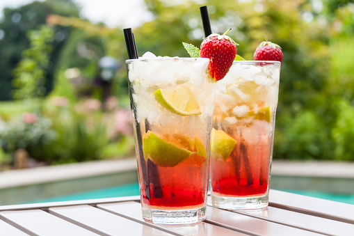 Strawberry Caipirinha with fresh mint and strawberry in glasses - gettyimageskorea