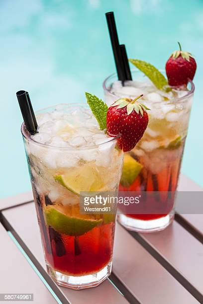 Strawberry Caipirinha with fresh mint and strawberry in glasses