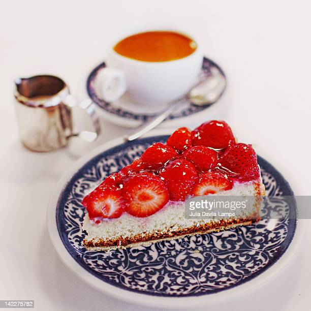 Strawberry cake and tea with milk