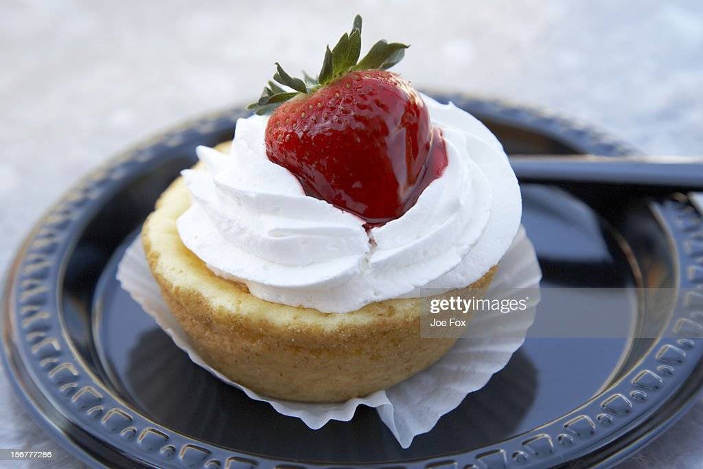 Strawberry cheesecake pastry on a plastic plate : Stock Photo