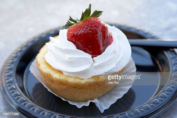 strawberry cheesecake pastry on a plastic plate - plastic plate stock photos and pictures