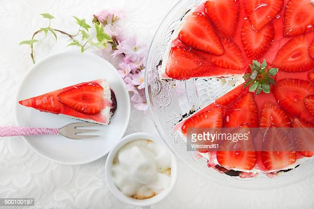 Strawberry cream cheese tart on cake stand and slice of strawberry cream cheese tart, elevated view