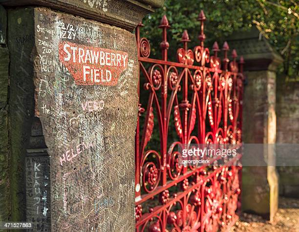 strawberry field gates in liverpool - strawberry fields stock photos and pictures