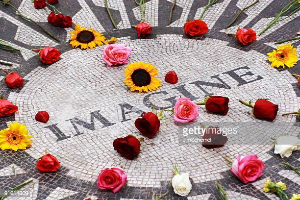strawberry fields central park - john lennons memorial stock photos and pictures