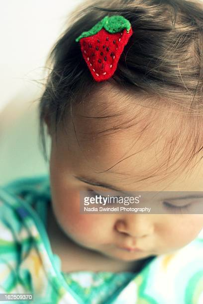 strawberry hair clip in baby's hair - weybridge stock photos and pictures