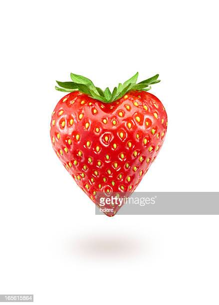a strawberry in the shape of a heart - strawberry stock pictures, royalty-free photos & images