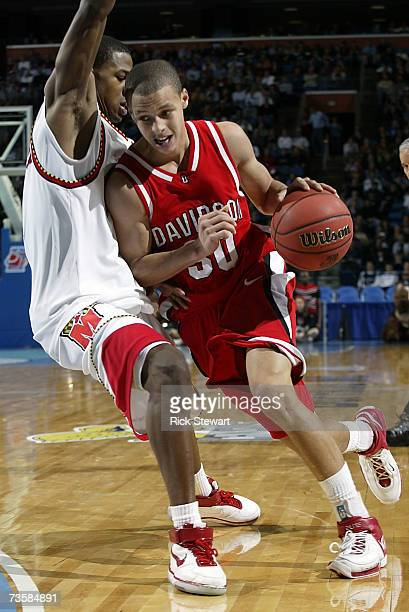 Strawberry of the Maryland Terrapins defends the drive of Stephen Curry of the Davidson Wildcats during round one of the NCAA Men's Basketball...