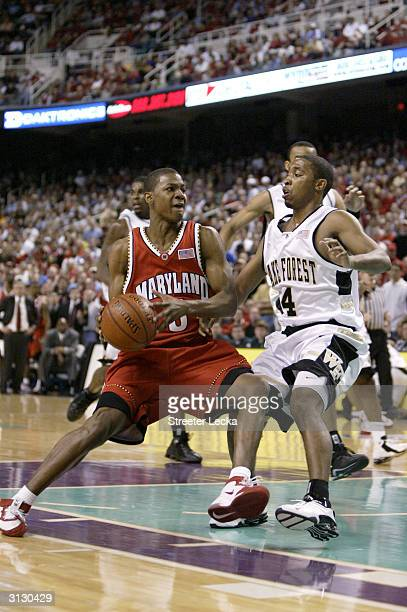 J Strawberry of the Maryland Terrapins drives on Taron Downey of the Wake Forest Demon Deacons in the ACC Quarterfinal game on March 12 2004 at the...
