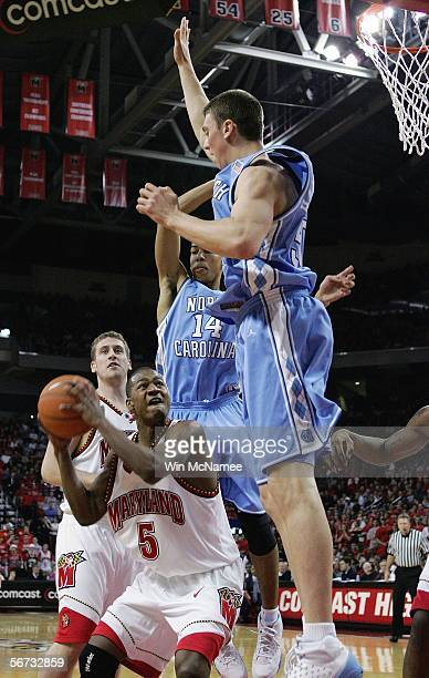 J Strawberry of the Maryland Terrapins drives to the basket against Tyler Hansbrough and Danny Green of the North Carolina Tar Heels during first...
