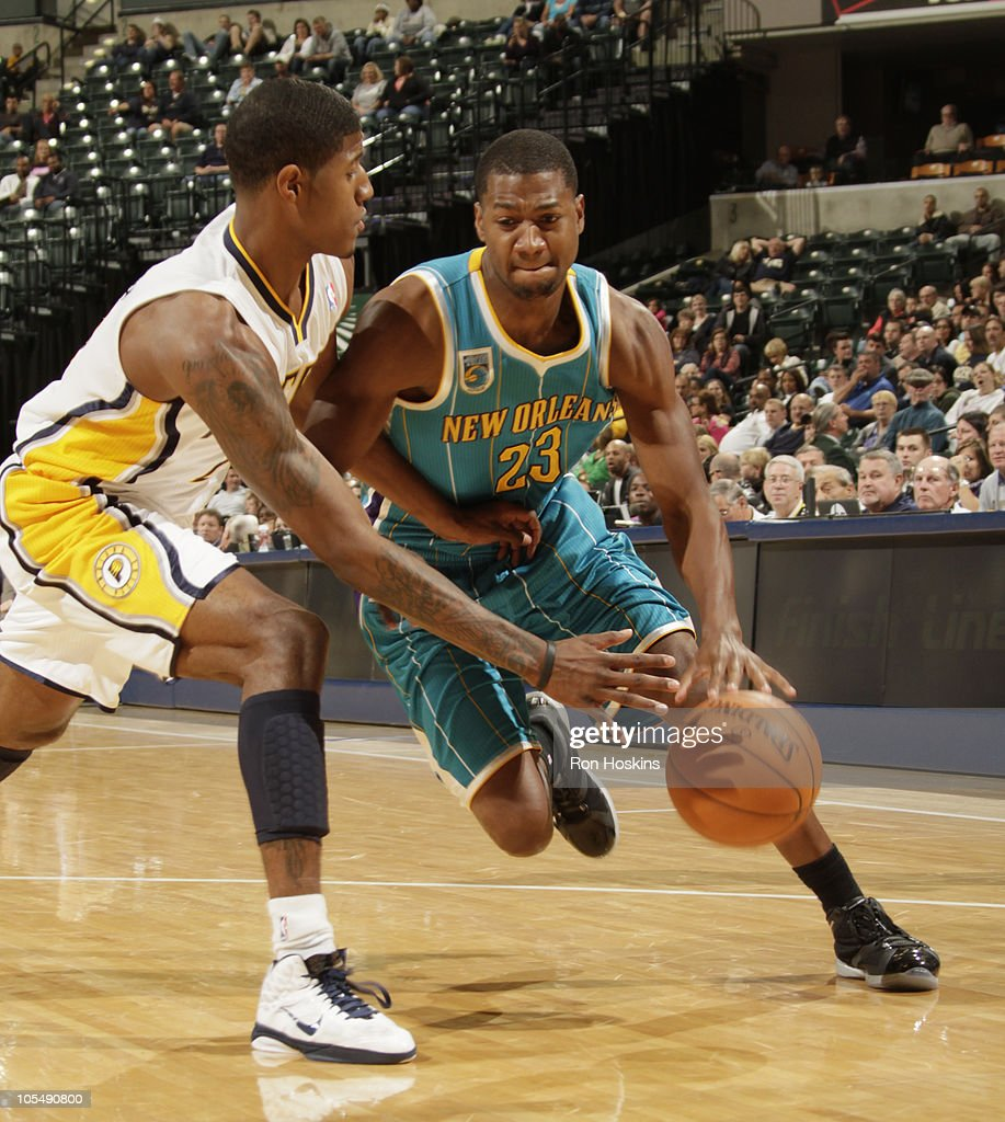 db0df3c957d D. J. Strawberry  23 of the New Orleans Hornets moves on Paul George  24 of