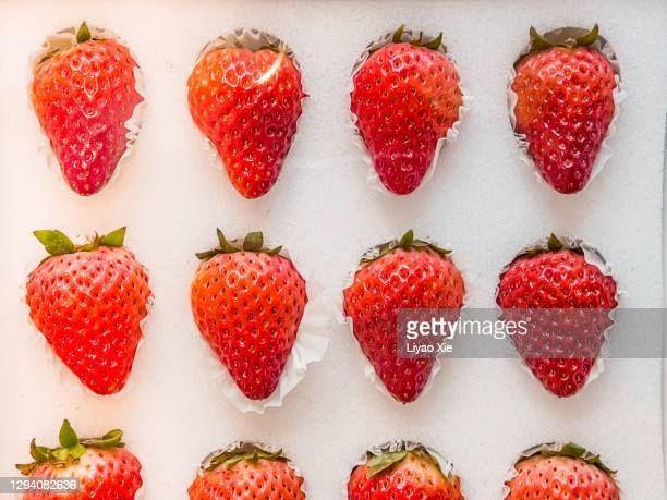 strawberry on sell - liyao xie stock pictures, royalty-free photos & images