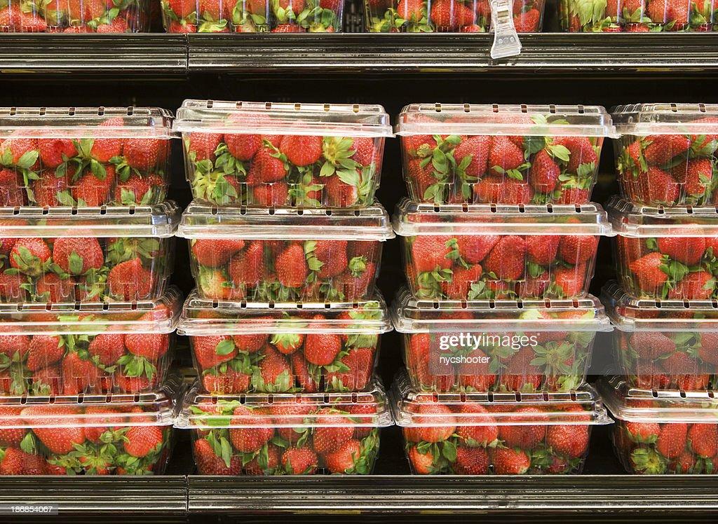 Strawberry on supermarket shelf : Stock Photo
