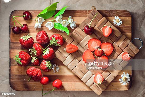 Strawberry on wooden cutting board